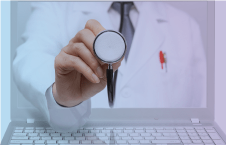 Doctor coming out of computer screen representing telehealth