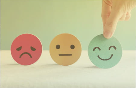 icons for red sad face, yellow neutral face and green happy face